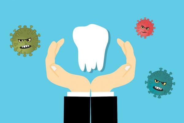 Carton viruses float around a cartoon tooth being held between a pair of cartoon hands.
