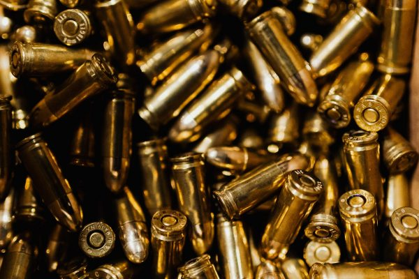 A large number of gold-colored bullets.